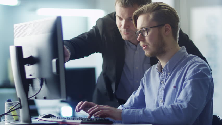 Businessman Have Discussion with Trainee on Workplace. Shot on RED Cinema Camera in 4K (UHD). Its easy scale, rotate and crop without loosing quality.  | Shutterstock HD Video #9030244