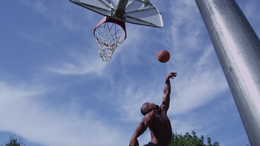 One on one street basketball; player is blocked #9032380