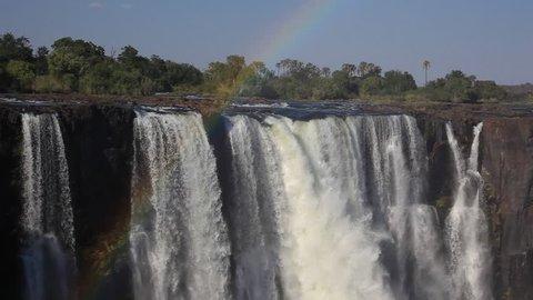 Rainbow over the world famous Victoria Falls waterfall, Zimbabwe