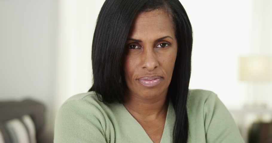 Serious black senior woman looking at camera #9063323