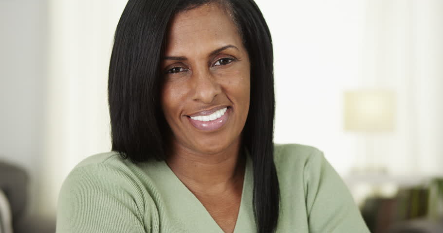 Black senior woman smiling at camera #9063335