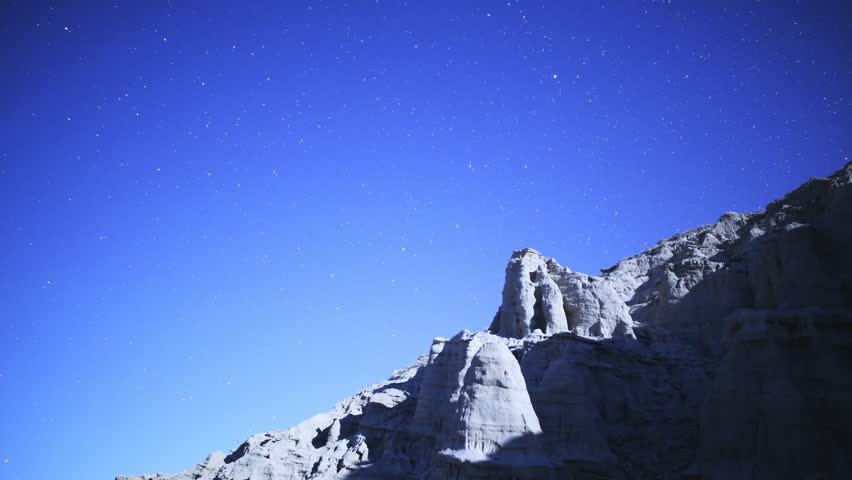 4K Astrophotography time lapse footage with tilt down motion of moon setting over eroded desert rock formation in Red Rock Canyon State Park, California | Shutterstock HD Video #9063503