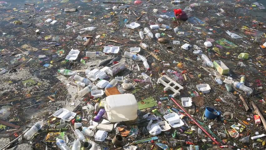 Plastic bottles and other trash floating in ocean  #9097265