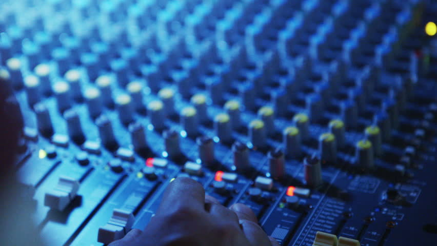 Close up of man's hand working a sound board   Shutterstock HD Video #9118823
