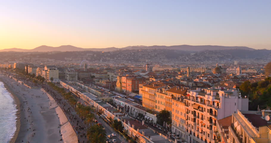 Nice, France view at sunset. Mediterranean sea Cote Dazur. Blue sky and aerial of promenade. Panoramic of city coast, beach. Travel, tourism in summer Europe. Bay coastline shore seaside landscape.