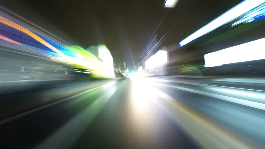 POV hyperlapse from a car driving on the highway in rain. Street lights, headlights, and city illumination and raindrops collecting on the lens. | Shutterstock HD Video #9127517