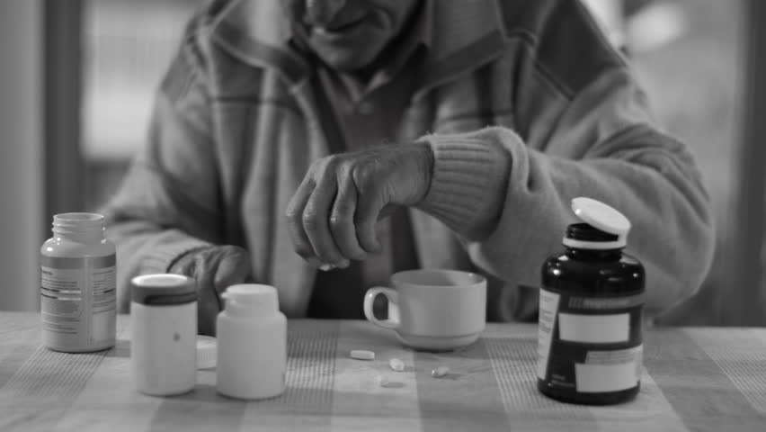 4K b&w Portrait of senior man taking pills from several containers of medication | Shutterstock HD Video #9129188