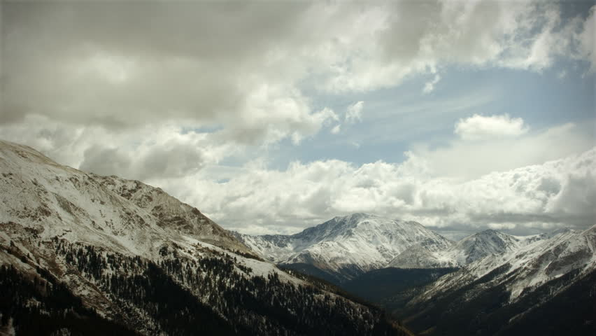 Early Snow Storm Mountain Pass Colorado, LOOPING! Great for themes of nature, travel, wilderness, seasons, weather, mountains, exploration, outdoor recreation, adventure.