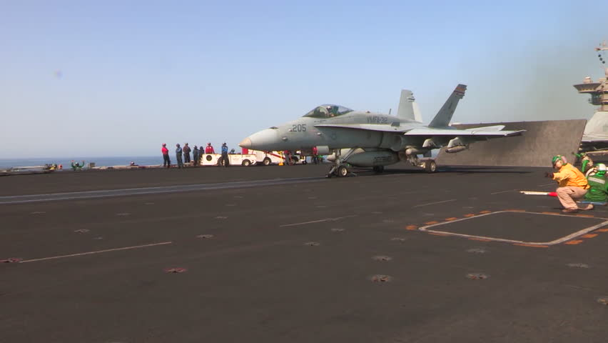 CIRCA 2010s - Various jet aircraft take off from the deck of an aircraft carrier.