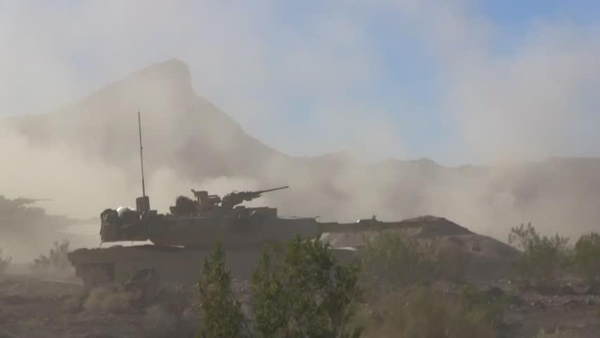 CIRCA 2010s - U.S. army tanks fire in the desert.