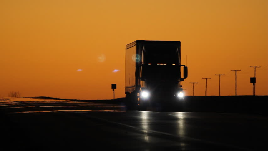 Oncoming truck with headlights at dusk. Saskatchewan, Canada.