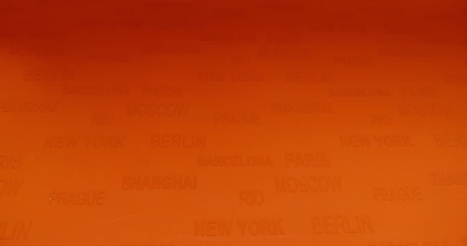 An orange background with world famous cities on it - the shot moves from the top to the bottom/We wish you a good vacation | Shutterstock HD Video #9160673