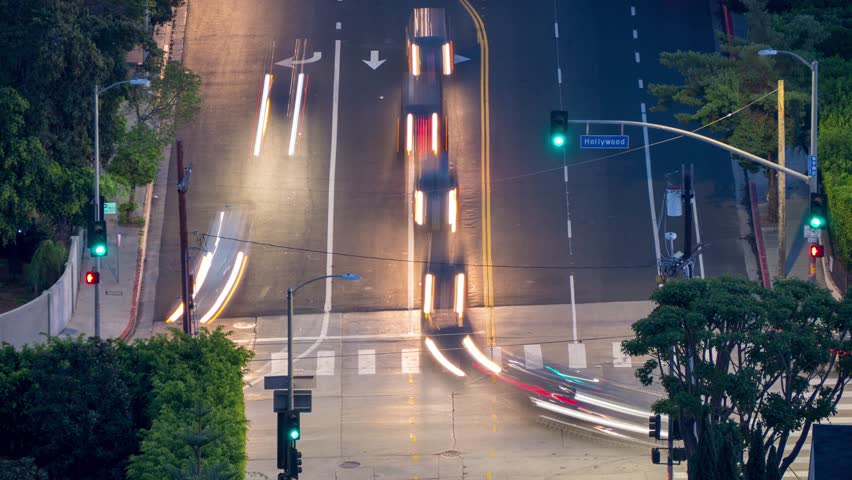 Aerial view of car traffic at Hollywood Boulevard in Los Angeles, California. 4K UHD timelapse.