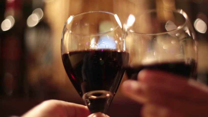 """Various wine glass """"Cheers"""" shots with a couple at a fine dining establishment #9162479"""