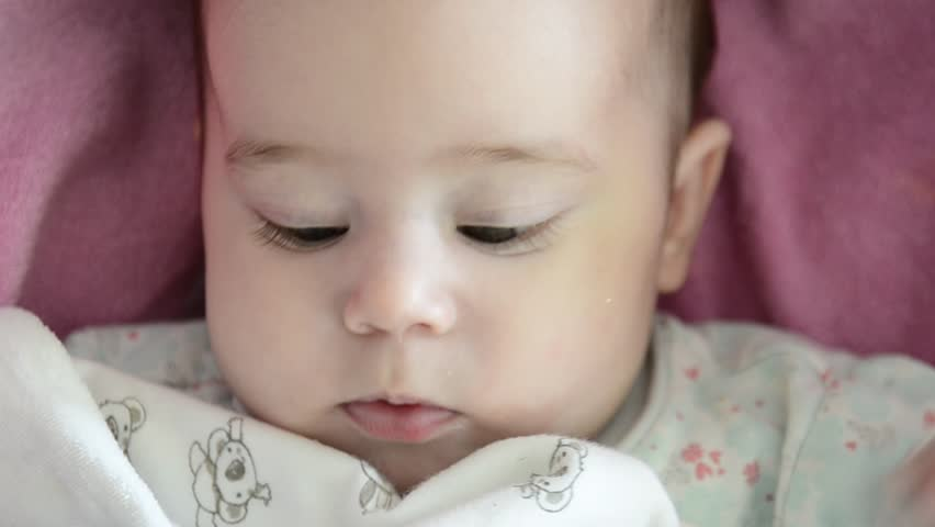 Close-up of baby girl's face who is babbling