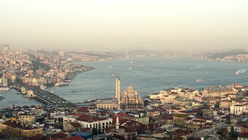 Aerial view of Istanbul city, skyline, Bosphorus, Bosporus sea, edge, New Mosque, marine traffic, Galata Bridge on day time, sunny weather.
