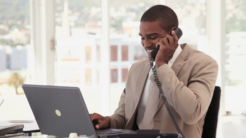 Businessman Using a Phone at the Office | Shutterstock HD Video #922243