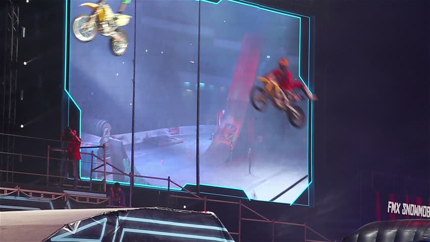 """MOSCOW, RUSSIA - MARCH 14, 2015: Big crazy moto show. Extreme Sport Motocross FMX Riders Big Jump, slow motion. International Festival of Extreme Sports """"Breakthrough 2015"""". #9226511"""