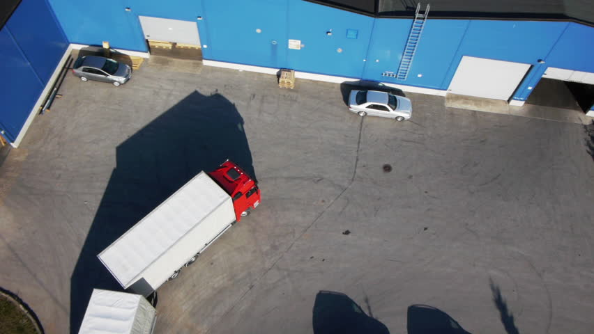 Truck is Driving to Logistics Center. Aerial Shot.
