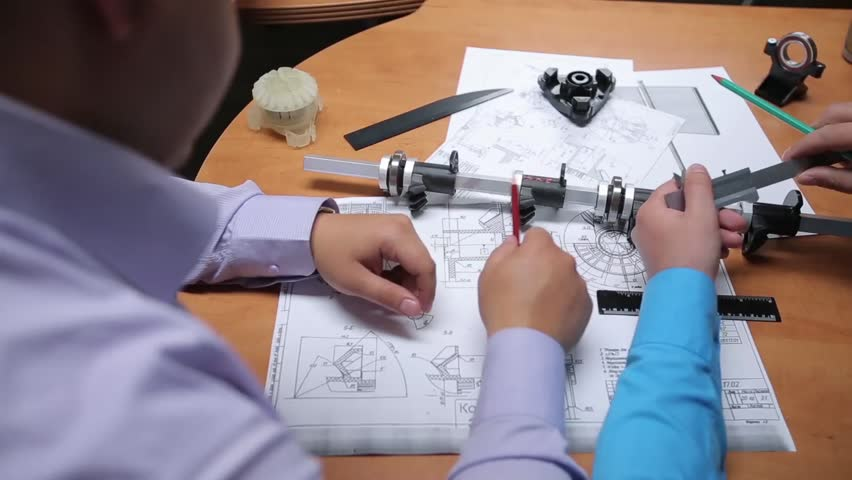 Design engineers discuss the project and make measurements | Shutterstock HD Video #9240077