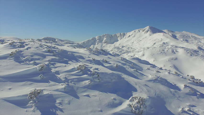 AERIAL: Snowy mountains in winter #9243302