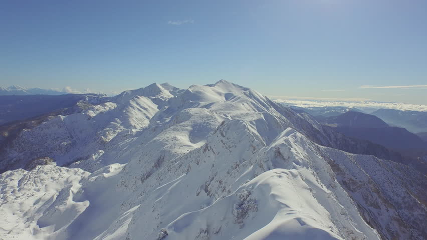 AERIAL: Huge snowy mountains in winter #9243323