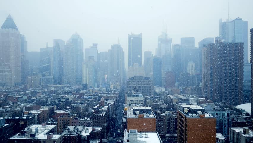 Romantic snow fall scenery in urban cityscape environment. skyline panorama. cold weather season