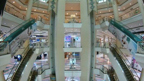 CHIANG MAI, THAILAND - MARCH 2015: (Time lapse View) Lifts and escalators move together with visitors in shopping center mall of Chiang Mai, Thailand.