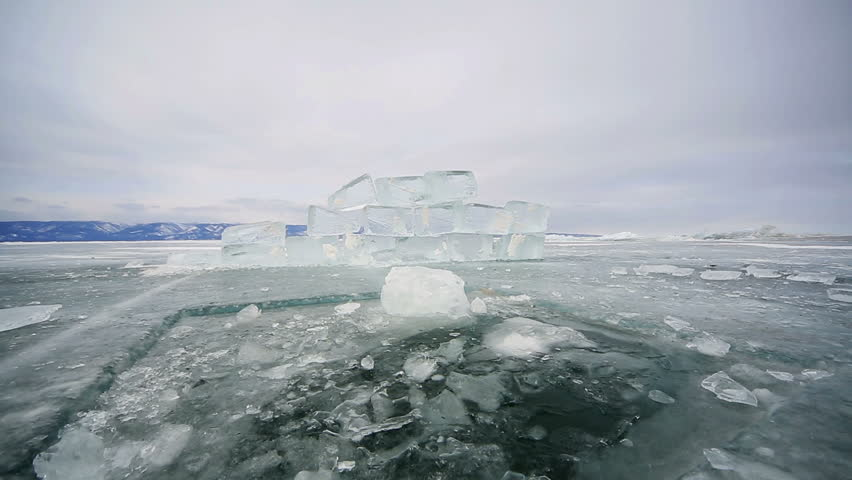 Hole in the ice Baikal ice, icy hole and block   Shutterstock HD Video #9284681