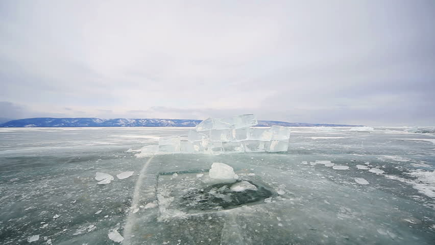 Hole in the ice Baikal ice, icy hole and block   Shutterstock HD Video #9284687