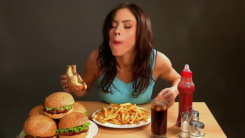 Woman Eating Fast Food.slim Girl Stock Footage Video (100% Royalty-free)  9299963 | Shutterstock