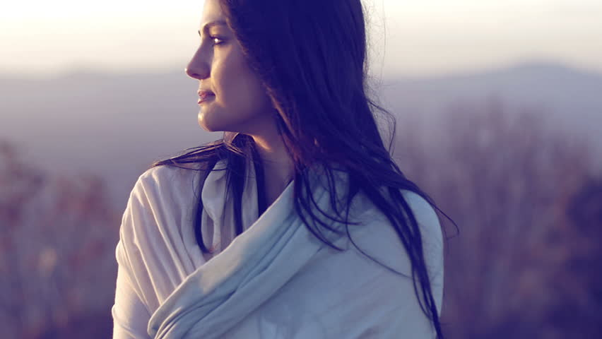 Relaxing beautiful woman at the sunset steady shot in slow motion    Shutterstock HD Video #9303485