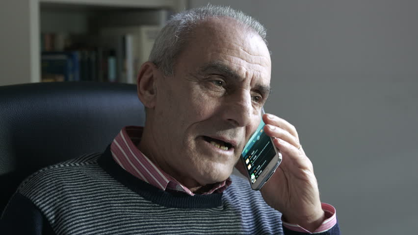 Angry Old Man Using Smartphone Stock Footage Video 100