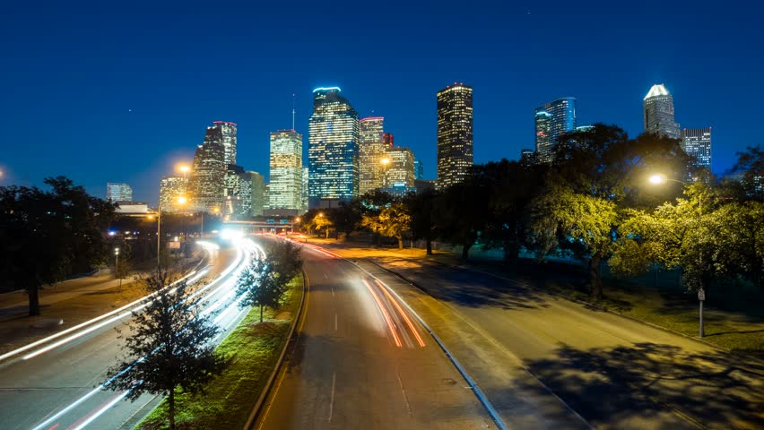 HOUSTON - 14 FEB: Timelapse view of the Houston City skyline at dusk with traffic moving at night, on 14 Feb 2015 in Houston, Texas, USA