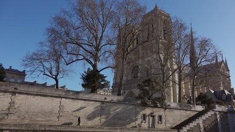 PARIS, FRANCE - MARCH 04; Establishing shot of Notre Dame Cathedral de Paris shot from Seine river, in Paris 2015. Pan movement - 1080p