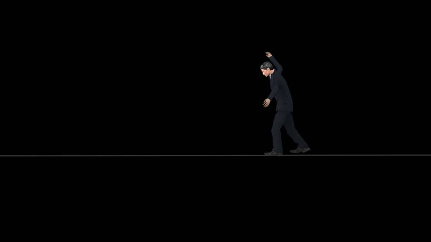 Man in a suit walking a tightrope on a black background. Comes with Alpha.