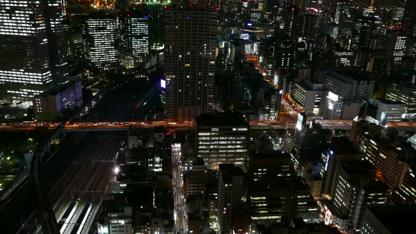 Elevated timelapse of rapid Friday night commuter transportation on highways and railroads in downtown Tokyo. | Shutterstock HD Video #9424040