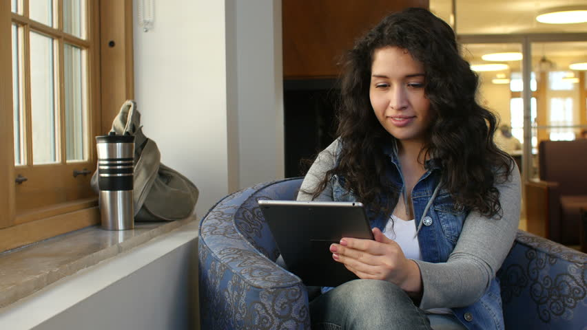 Hispanic female with tablet | Shutterstock HD Video #9427169