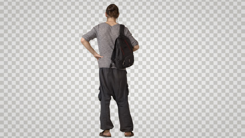 Standing young man in ethnic clothes waits. Yogi with man's bun Back view Footage with alpha channel. File format - mov. Codec - PNG+Alpha Combine these footage with other people to make crowd effect