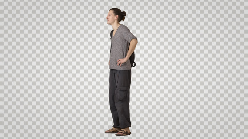 Standing young man in ethnic clothes waits. Yogi with man's bun Side view Footage with alpha channel. File format - mov. Codec - PNG+Alpha Combine these footage with other people to make crowd effect