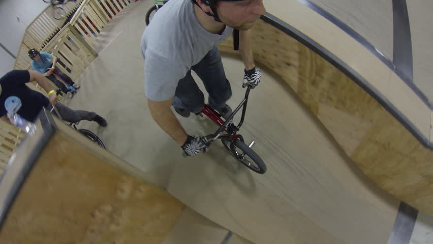 """Ottawa, Canada - March 2015 - BMX riders wearing a unique GoPro mount ride the city's brand new """"Epic Indoor bike park"""" on it's opening day. 
