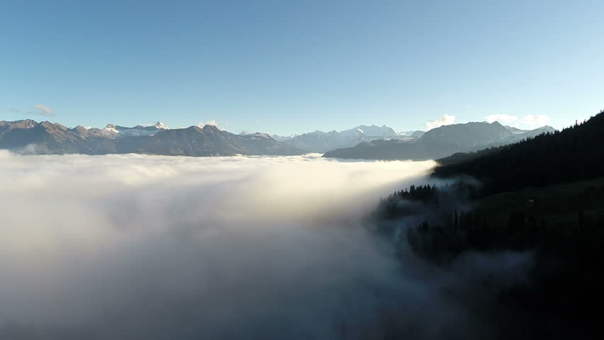 Aerial view of the last sun rays into a sea of fog, Switzerland #9457406