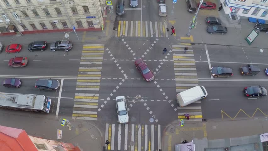 MOSCOW - NOV 18, 2014: Transport ride by crossroad at autumn day. Aerial view in timelapse #9466289
