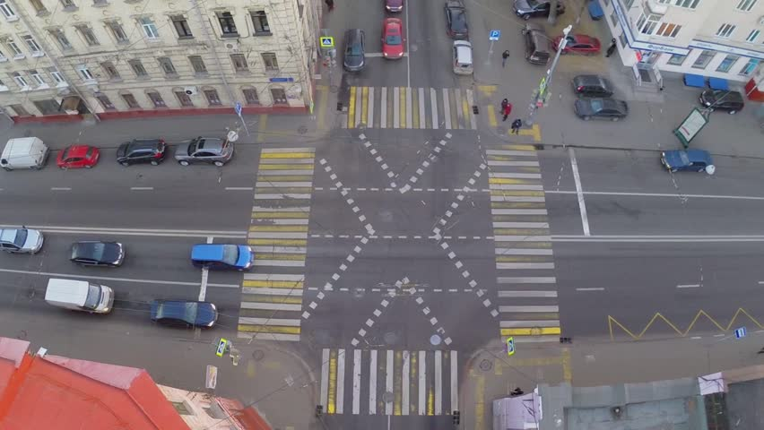 MOSCOW - NOV 18, 2014: Car and trolley ride by crossroad at autumn day. Aerial view #9466367