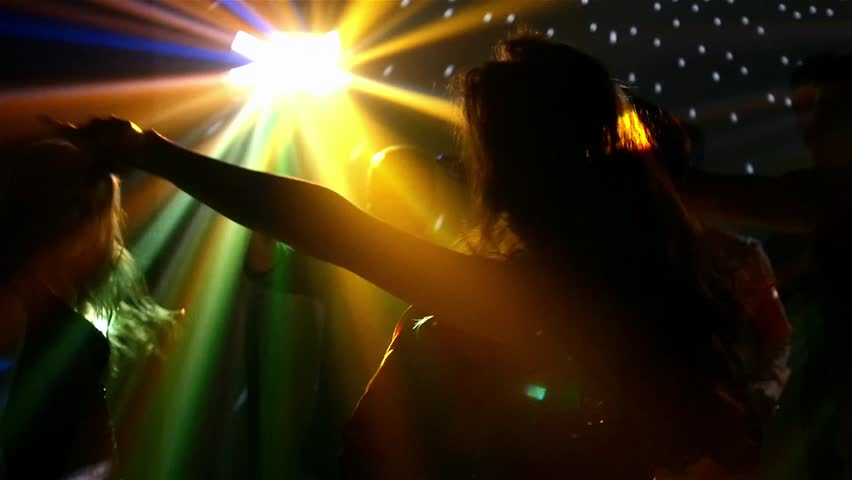 pair of dancers dancing in the spotlight at the club, silhouette,light falls beautifully on their body, Slow motion