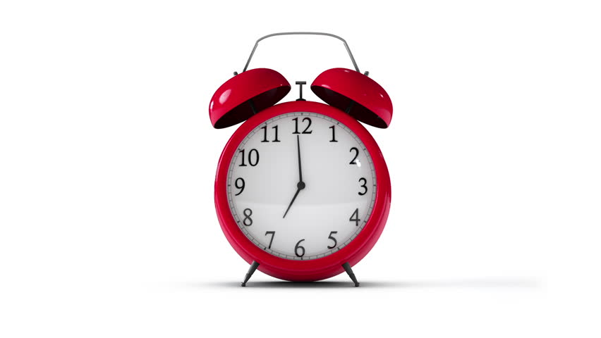 Classic red alarm clock going off on isolated background