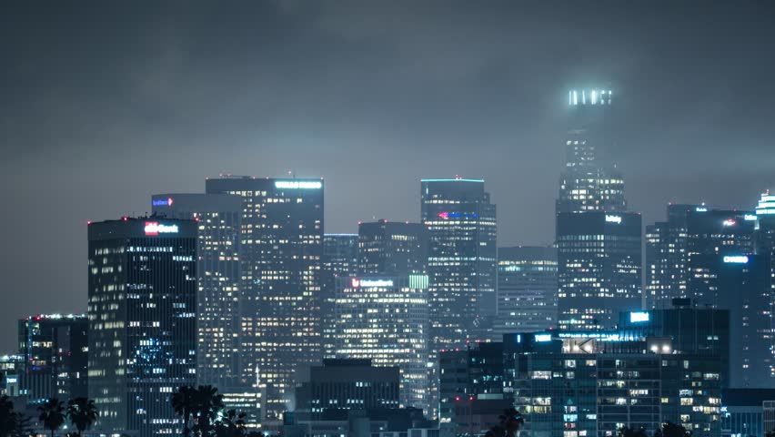 Storm clouds moving over downtown Los Angeles skyline. 4K UHD timelapse.