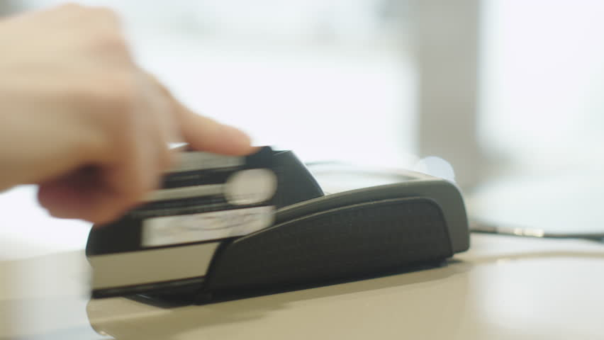 Using Credit Card Terminal with Magnetic Stripe. Shot on RED Cinema Camera in 4K (UHD) | Shutterstock HD Video #9516233