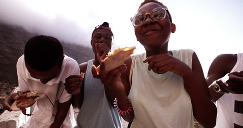 Happy american friends cheerful together while eating pizza in Slow Motion