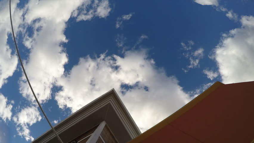 Time Lapse Clouds moving past building sharp edges   Shutterstock HD Video #9547319
